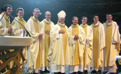 The eight new priests with their Bishop
